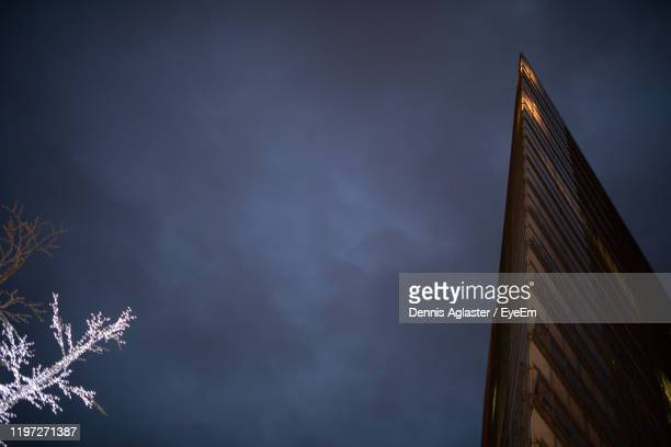 low angle view of silhouette building against sky at dusk - storm dennis stock pictures, royalty-free photos & images