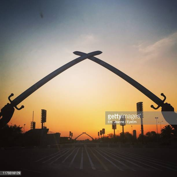 low angle view of silhouette buildings against sky during sunset - baghdad stock pictures, royalty-free photos & images