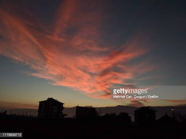 low angle view of silhouette buildings against sky during sunset - bolu city stock photos and pictures