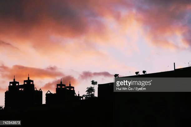 Low Angle View Of Silhouette Buildings Against Sky