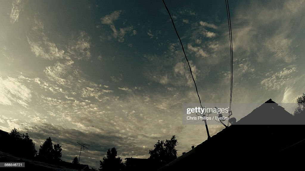Low Angle View Of Silhouette Cables Against Sky : Foto de stock