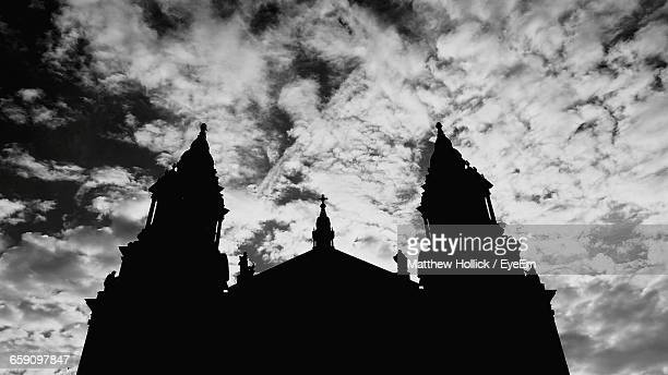 Low Angle View Of Silhouette Church Against Cloudy Sky