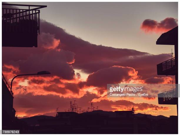 low angle view of silhouette city against sky during sunset - costangelo pacilio foto e immagini stock