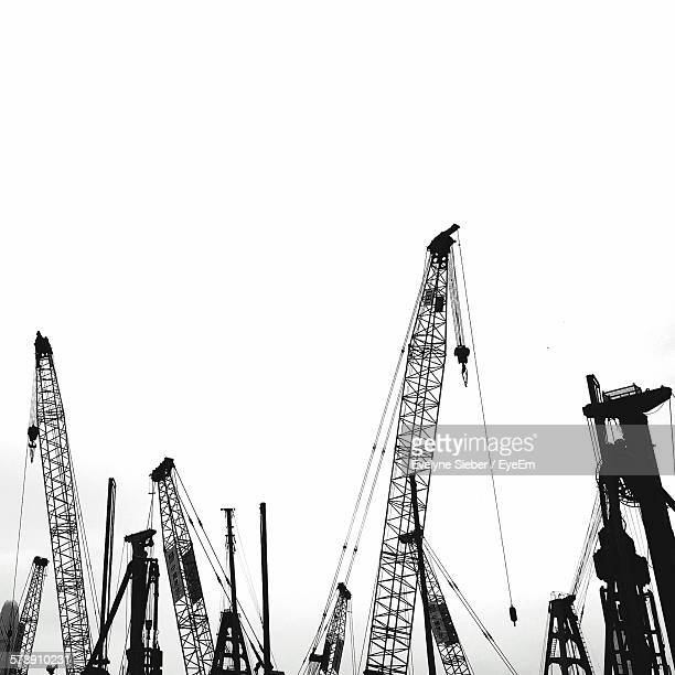 Low Angle View Of Silhouette Cranes Against Clear Sky
