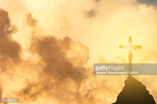 low angle view of silhouette cross against sky during sunset - crucifix stock pictures, royalty-free photos & images