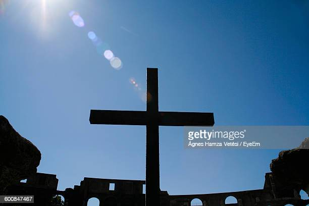 Low Angle View Of Silhouette Cross At Historic Colosseum Against Clear Sky