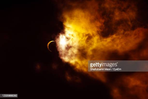 low angle view of silhouette moon against sky at night - shaifulzamri stock pictures, royalty-free photos & images