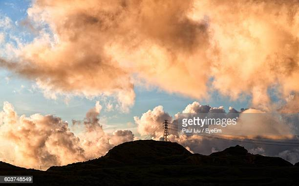 low angle view of silhouette mountain against cloudy sky at sunset - liu he stock pictures, royalty-free photos & images