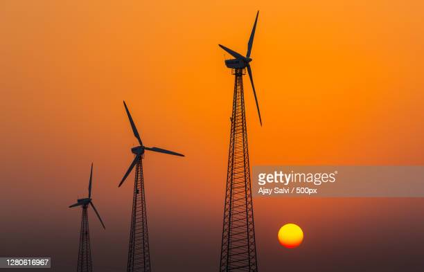 low angle view of silhouette of windmills against sky during sunset,jodhpur,rajasthan,india - images stock pictures, royalty-free photos & images
