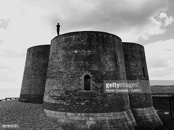 Low Angle View Of Silhouette Person Standing On Martello Towers
