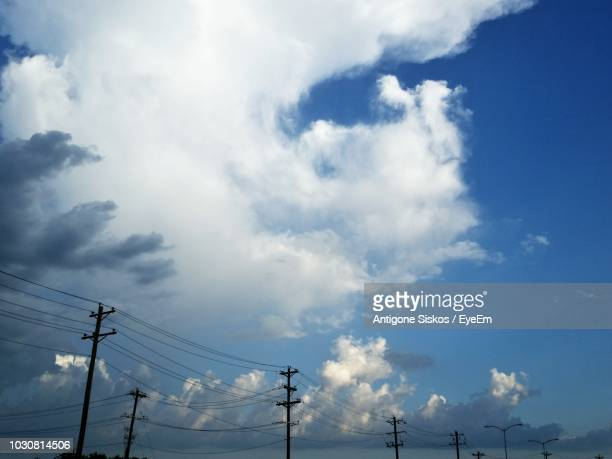 Low Angle View Of Silhouette Power Lines Against Sky
