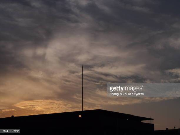 Low Angle View Of Silhouette Roof Against Sky