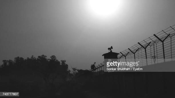 low angle view of silhouette trees against clear sky - prison building stock pictures, royalty-free photos & images