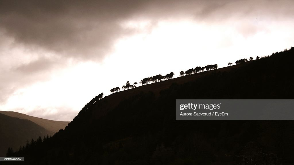 Low Angle View Of Silhouette Trees On Mountain Against Sky : Stock Photo