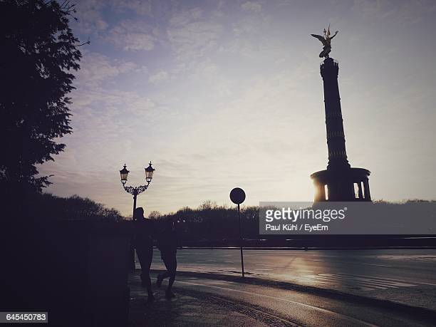 Low Angle View Of Silhouette Victory Column Against Sky During Sunset
