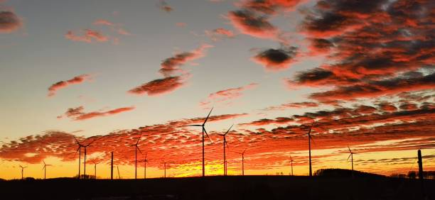 Low Angle View Of Silhouette Windmills Against Dramatic Sky