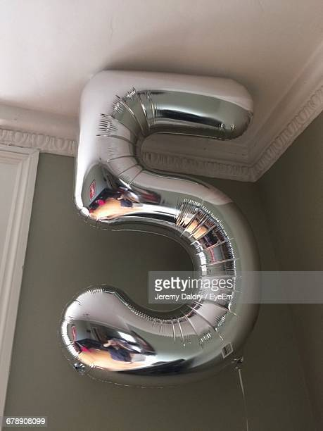Low Angle View Of Silver Number 5 Helium Balloon At Home