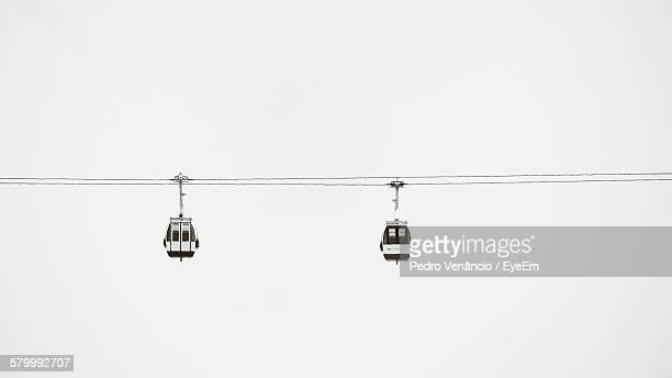 low angle view of ski lifts against clear sky - ski lift stock pictures, royalty-free photos & images