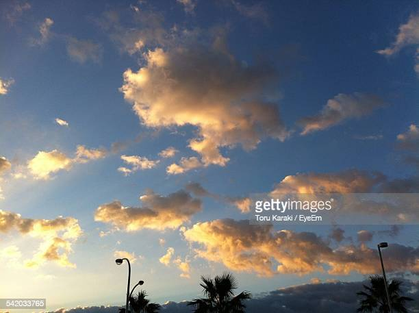 Low Angle View Of Sky And Clouds At Sunset