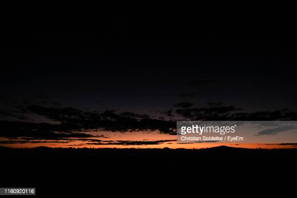 low angle view of sky during sunset - christian soldatke stock pictures, royalty-free photos & images