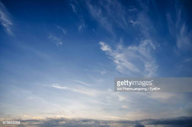 low angle view of sky during sunset - wispy stock photos and pictures