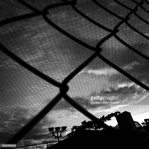 Low Angle View Of Sky Seen Through Chainlink Fence