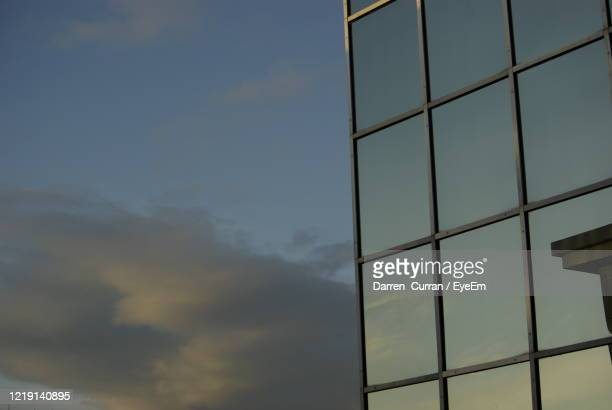 low angle view of sky seen through glass window - curran stock pictures, royalty-free photos & images