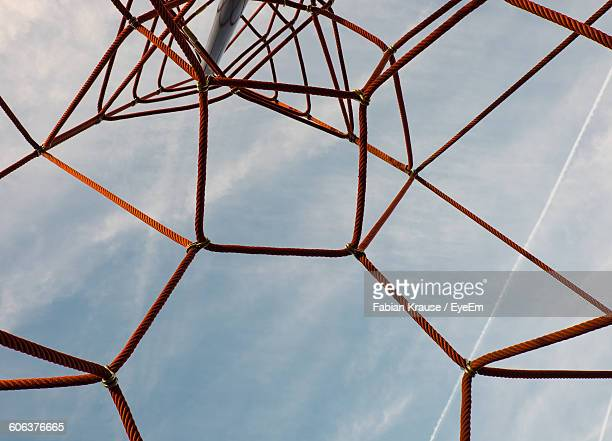 Low Angle View Of Sky Seen Through Ropes