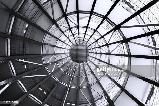 low angle view of skylight in building - concentric stock pictures, royalty-free photos & images