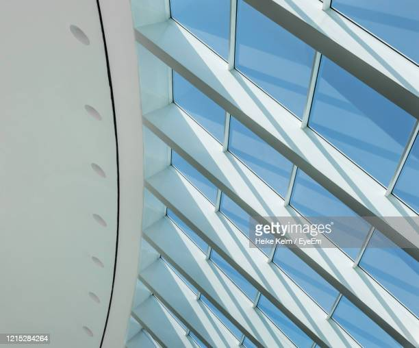 low angle view of skylight in building - fensterfront stock-fotos und bilder