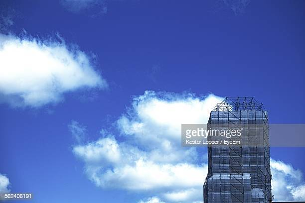 Low Angle View Of Skyscraper Against Cloudy Sky