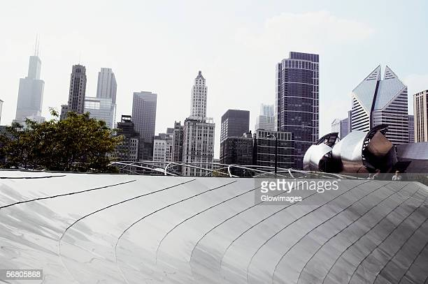 low angle view of skyscraper in a city, chicago, illinois, usa - millenium park stock photos and pictures
