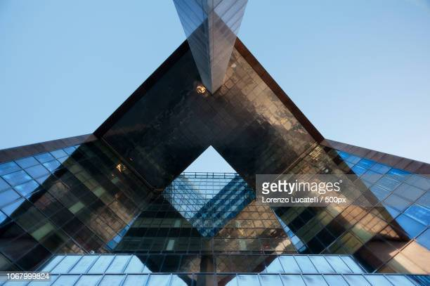 low angle view of skyscraper - triangle shape stock pictures, royalty-free photos & images
