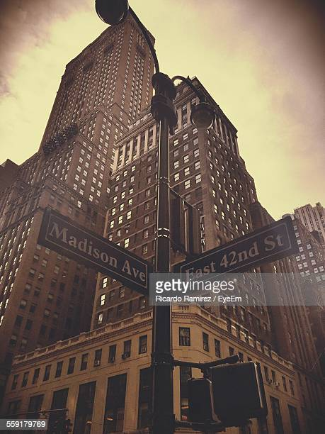 low angle view of skyscraper - madison avenue stock pictures, royalty-free photos & images