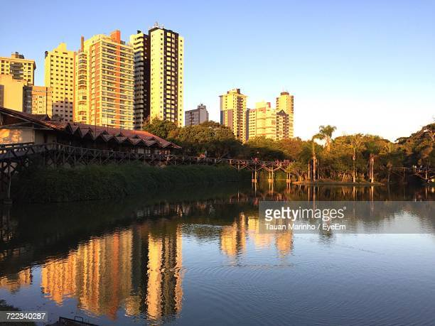 low angle view of skyscrapers against blue sky - curitiba stock pictures, royalty-free photos & images