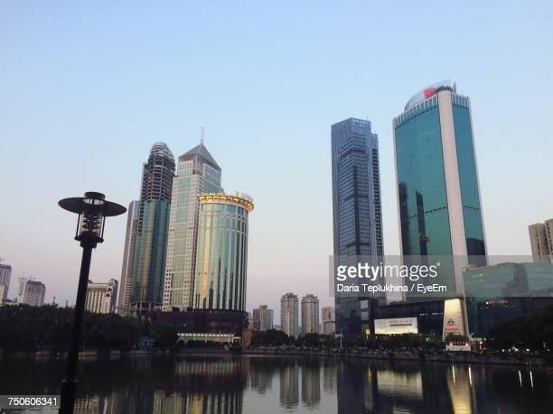 low angle view of skyscrapers against clear sky - wuhan ストックフォトと画像