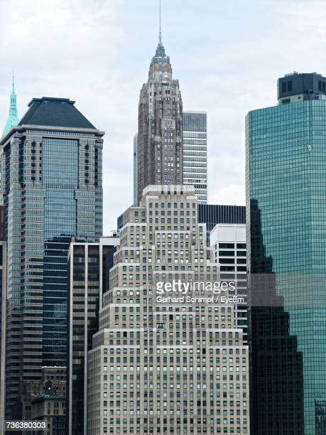 low angle view of skyscrapers against cloudy sky - gerhard schimpf stock pictures, royalty-free photos & images