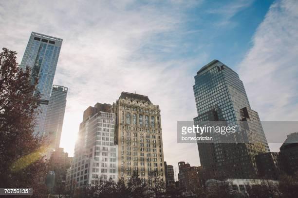 low angle view of skyscrapers against sky - bortes foto e immagini stock