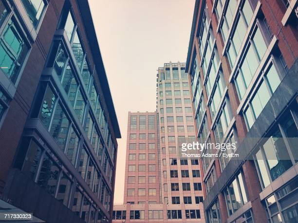 low angle view of skyscrapers against sky - fairfax county virginia stock photos and pictures