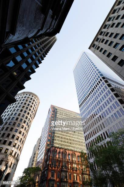 low angle view of skyscrapers against sky - providence rhode island stock photos and pictures
