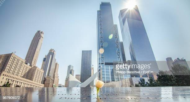 low angle view of skyscrapers against sky - monument stock pictures, royalty-free photos & images