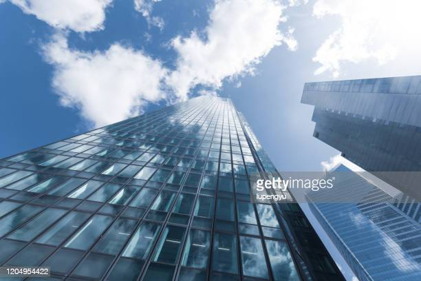 low angle view of skyscrapers at la defense,paris - finance and economy stock pictures, royalty-free photos & images
