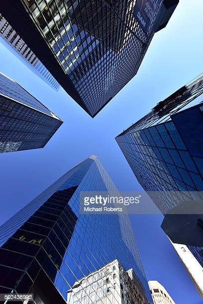 low angle view of skyscrapers in manhattan, new york - directly below stock pictures, royalty-free photos & images