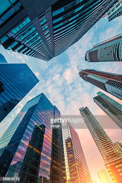 low angle view of skyscrapers in toronto downtown - surrounding stock pictures, royalty-free photos & images