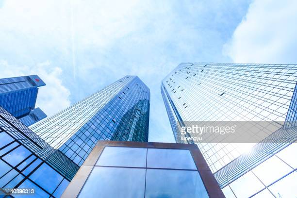 low angle view of skyscrapers - skyscraper imagens e fotografias de stock