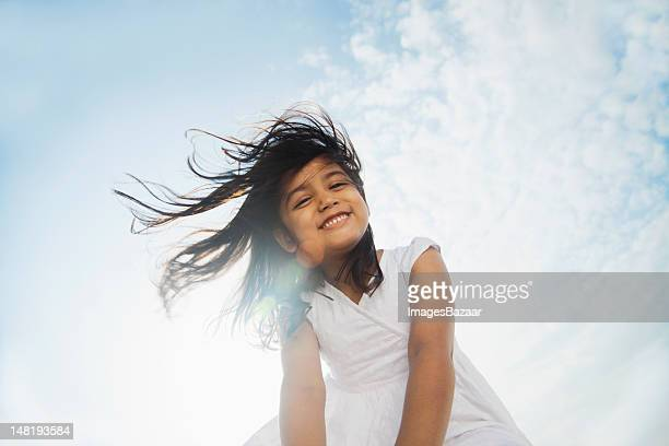 low angle view of smiling girl (6-7) - low angle view stock pictures, royalty-free photos & images