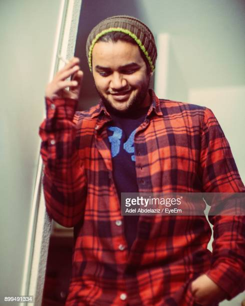 low angle view of smiling man smoking cigarette - rhone alpes stock photos and pictures