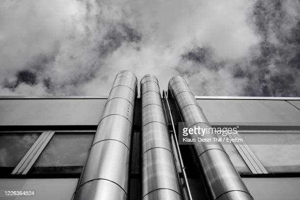 low angle view of smoke stack against sky - klaus-dieter thill stock-fotos und bilder