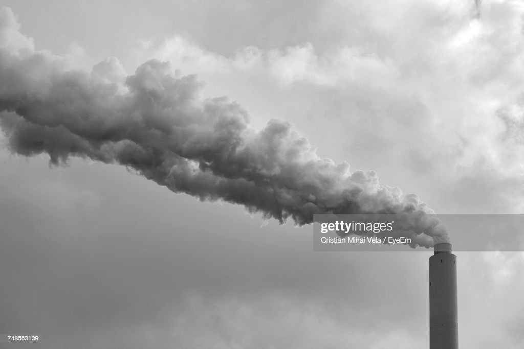 Low Angle View Of Smoke Stack Against Sky : Stock Photo