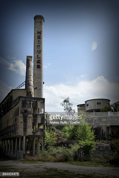 Low Angle View Of Smoke Stack In Abandoned Factory Against Sky